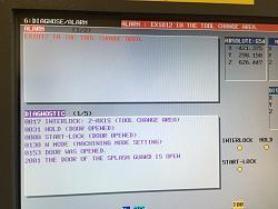 Alarm EX1012 IN THE TOOL CHANGE AREA (Fanuc Robodrill ?-T21iFa)-img_7052-jpg