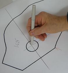 tracing a backhoe bucket part-closeup-jpg